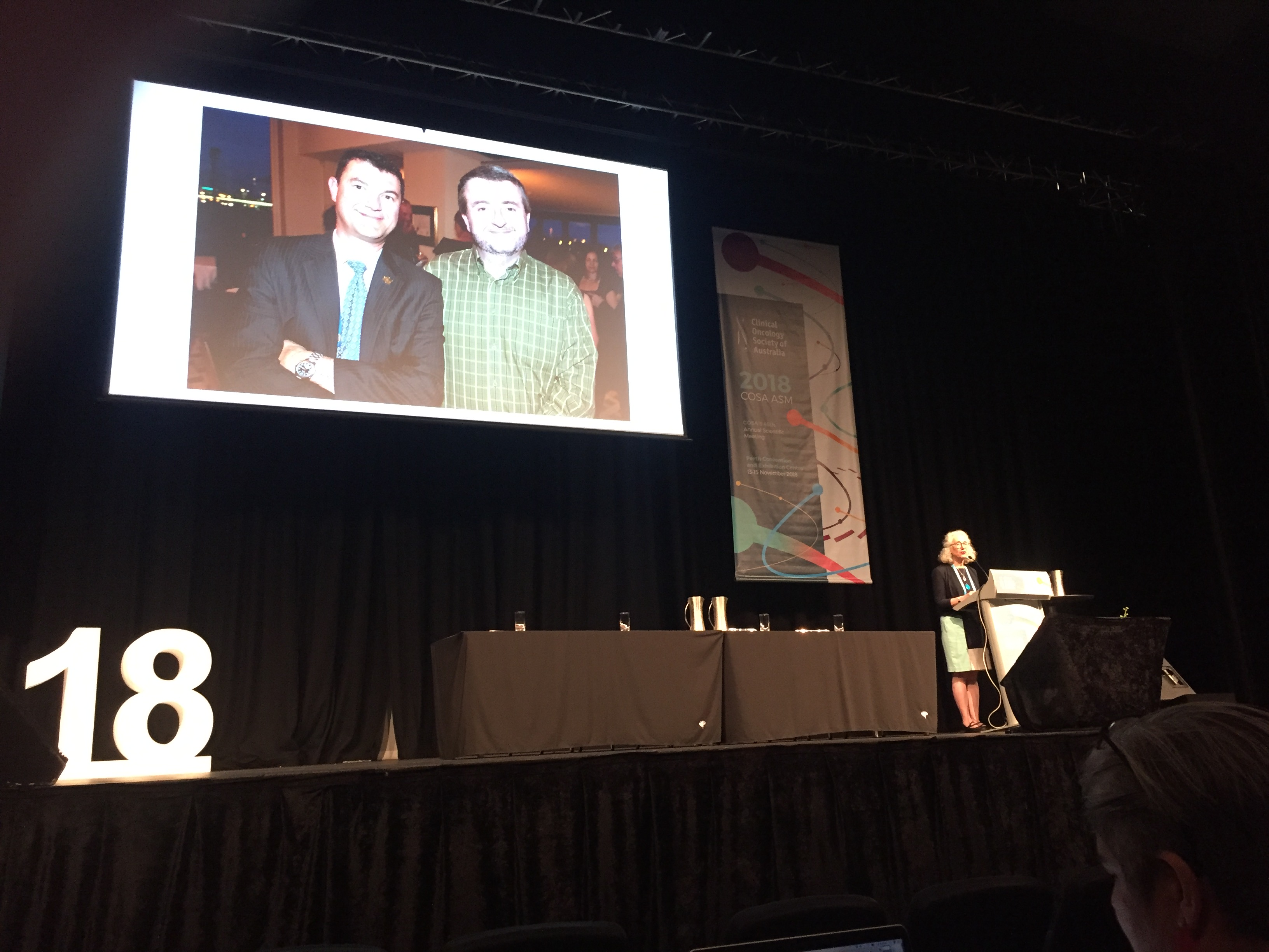 COSA President Phyllis Butow presenting a tribute on stage at the COSA 2018 opening ceremony at Perth Convention and Exhibition Centre