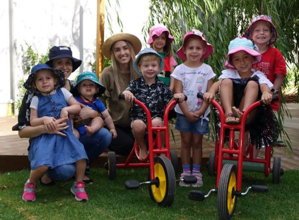 L-R: Isabella (3 years 7 months), mum Alycia and Harrison (11 months) Simmonds, Jessica Farwell (teacher), Lenny (4 years), Eliska (3 years 9 months), Katie (4 years), Maniya (4 years) and Jack (4 years 2 months).